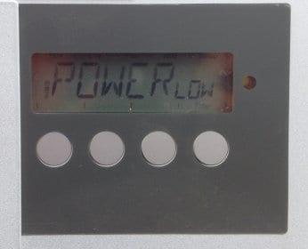 A Fronius IG solar inverter showing a POWER LOW fault code